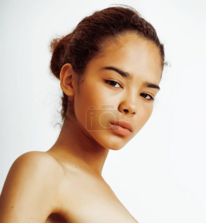 young pretty african american woman close up isolated on white background, asian mulatto tanned nude makeup, lifestyle spa real beauty people concept sport
