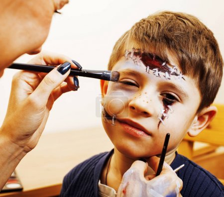 little cute child making facepaint