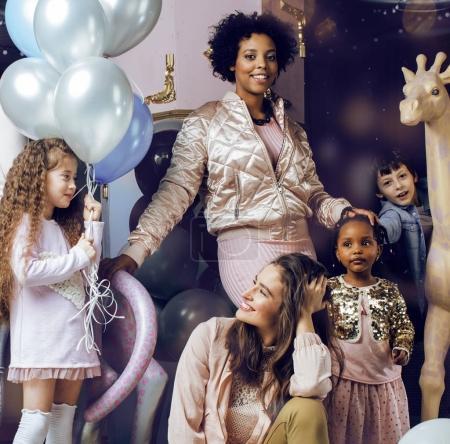 Diversity nations women with children celebrating