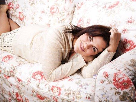 portrait of beautiful girl laying on sofa