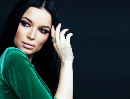 Photo for Young pretty brunette woman fashion dressed, bright makeup, elegant hair style close up - Royalty Free Image