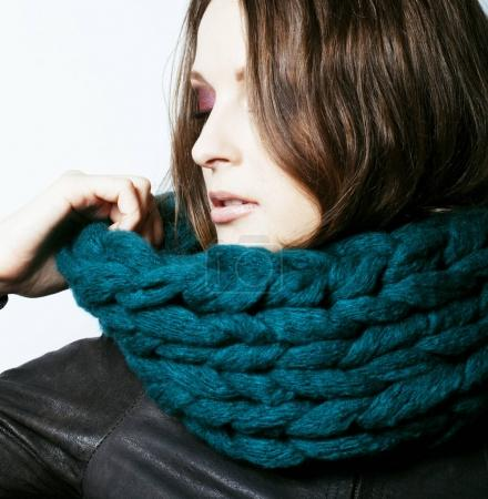 woman in sweater and scarf