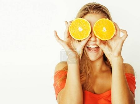 Photo for Young pretty blond woman with half oranges close up isolated on white bright teenage smiling copyspace - Royalty Free Image