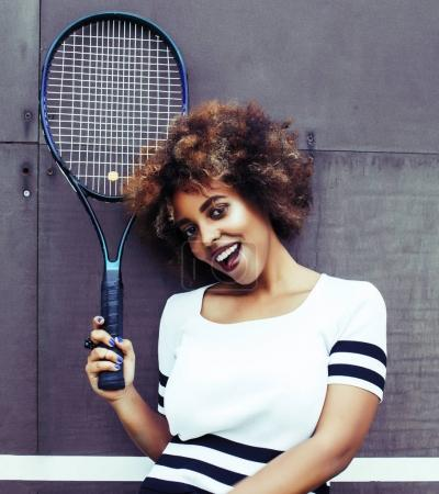 young stylish mulatto afro-american girl playing tennis, sport h