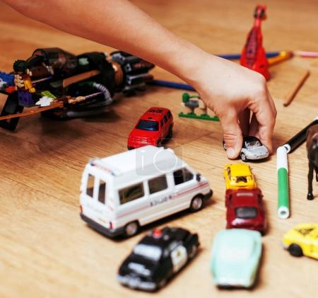 children playing toys on floor at home, little hand in mess, fre