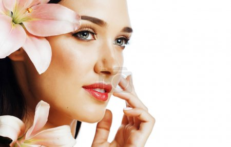 Photo for Young attractive caucasian lady close up with hands on face isolated flower lily brunette, spa people concept - Royalty Free Image