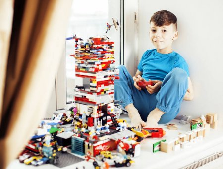 Photo for Little cute preschooler boy playing toys at home happy smiling, lifestyle children concept close up - Royalty Free Image