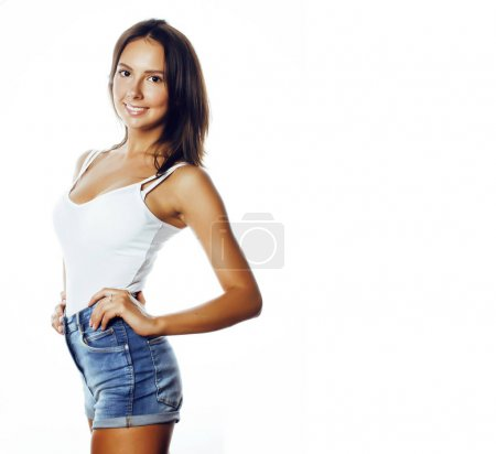 Young pretty stylish brunette hipster girl posing ...
