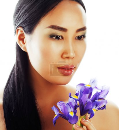 Photo for Young pretty asian woman with flower purple orchid close up isolated spa, womans day concept - Royalty Free Image