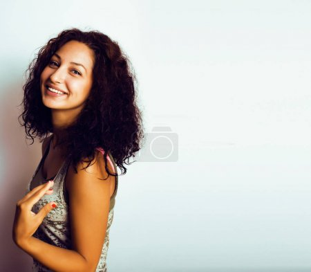 young happy smiling mulatto latin american teenage girl emotiona