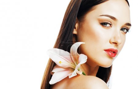 young attractive lady close up with hands on face isolated flowe