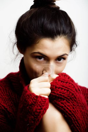 Photo for Young pretty brunette woman in sweater and scarf all over her face, lifestyle people winter concept - Royalty Free Image