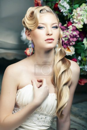 Photo for Beauty young bride alone in luxury vintage interior with a lot of flowers, makeup and creative hairstyle closeup - Royalty Free Image