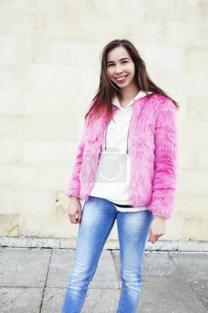 Photo for Young pretty teenage brunette girl happy smiling outside, lifestyle people concept closeup - Royalty Free Image