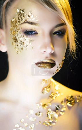 Photo for Beauty blond woman with gold creative fashion make up, people at holiday concept closeup - Royalty Free Image