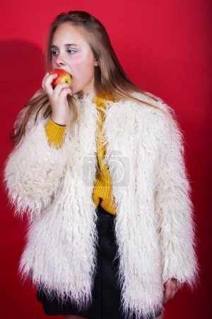 Photo for Young pretty emitonal posing teenage girl on bright red background, happy smiling lifestyle people concept closeup - Royalty Free Image