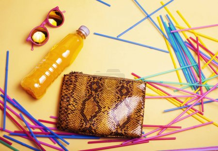 Photo for Summer stuff on yellow background close up top view - Royalty Free Image