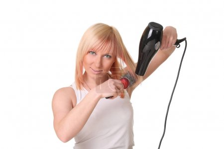 Woman with hair dryer and scissors