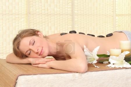 Beautiful Woman Getting Spa Massage in Spa Salon