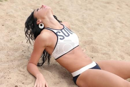 beautiful woman on the sand by the sea