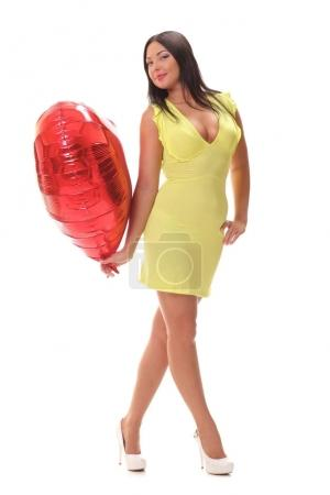 young woman with heart shape air balloon