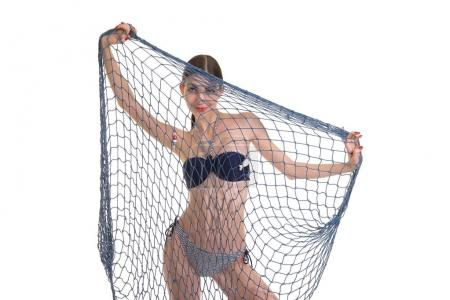 girl posing in bikini with fishing net
