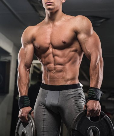 Man Lifting Heavy Weights In The Gym. Athletic sport lifestyle