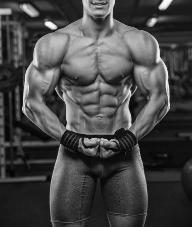 Brutal strong athletic men pumping up muscles workout bodybuildi