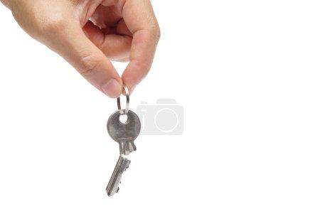 Closeup of hand holding a broken key