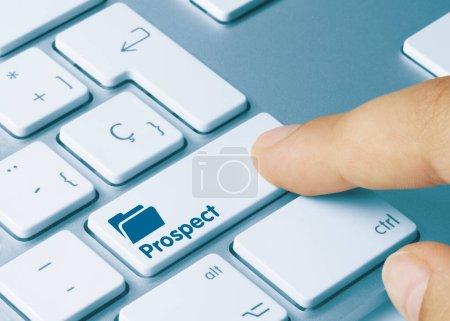 Prospect Escrito en Llave Azul del Teclado Metálico. Pulsando la tecla .