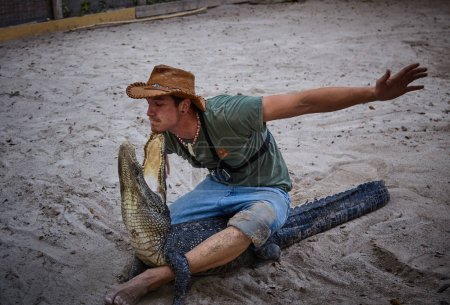 Photo for Brave man fighting crocodile at show - Royalty Free Image