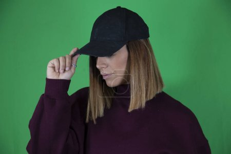 Photo for Woman with cap and chroma background - Royalty Free Image