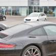 Постер, плакат: Closeup of Porsche cars