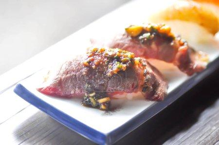 gyuuniku sushi , rice topped with raw beef (Japanese style)