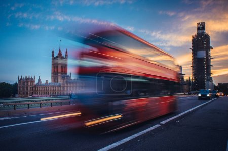 Photo for London. Classic red double decker bus crossing Westminster Bridge at sunset. - Royalty Free Image