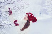 woman  in a winter snowy forest