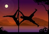 Halloween style silhouettes of male and female pole dancer performing duo tricks in front of river and full moon at night