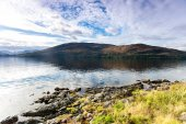 Landscape with beautiful scottish wild mountains and lake with r