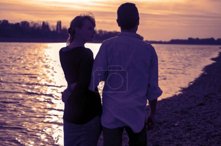 Photo for Couple in love at sunset - Royalty Free Image