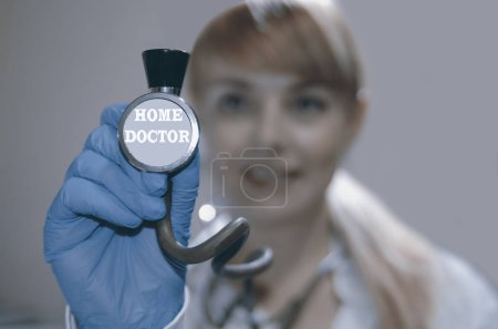 Photo for Doctor with stethoscope and syringe - Royalty Free Image