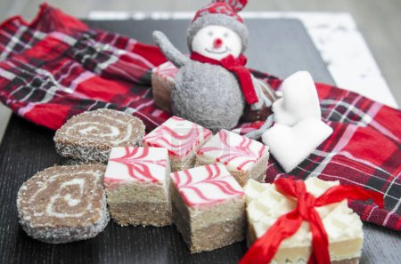 Photo for Christmas decoration with snowman and gift box on wooden background - Royalty Free Image