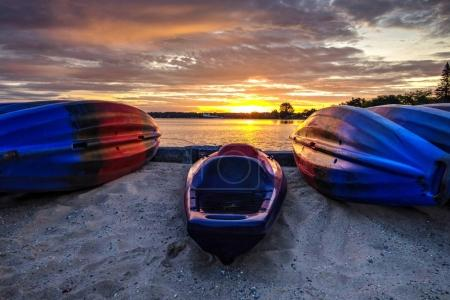 Kayak Sunrise. Kayaks on a sandy beach at sunrise on the Great Lakes coast of downtown Traverse City, Michigan.