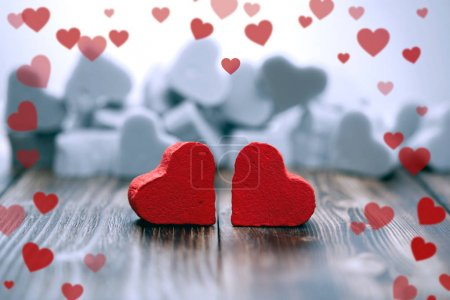 Photo for Two red hearts on a dark wooden background - Royalty Free Image