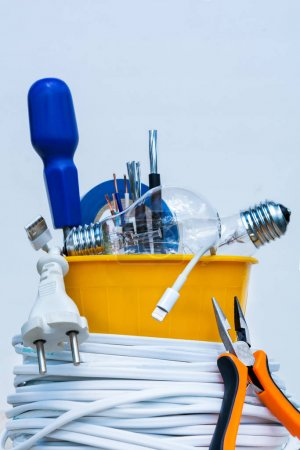Photo for Yellow plastic pot filled with electrician tools - Royalty Free Image