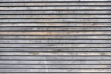 Foto de La textura de una antigua pared de madera de los tableros sin pintura.. - Imagen libre de derechos