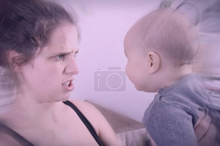 Mother suffering from postpartum depression shakes and screams at her baby