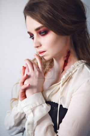 Photo for Close-up portrait of girl with fx make-up of vampire. Vampire bite. - Royalty Free Image