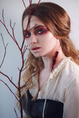 Close-up portrait of girl with fx make-up of vampire