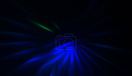 Photo for Light particles in motion, creating a burst of glowing multicolored rays on a black background. Energetic glow lights wallpaper. - Royalty Free Image