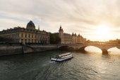 Boat tour on Seine river in Paris with sunset. Paris, Franc